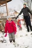 Bonhomme de neige de moule d'enfants Photographie stock libre de droits
