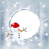 Bonhomme de neige sur l'étiquette Photographie stock libre de droits