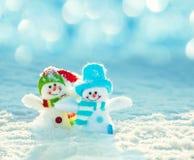 Bonhomme de neige sur la neige Photographie stock libre de droits
