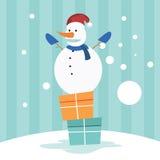Bonhomme de neige sur le boîte-cadeau Photos stock
