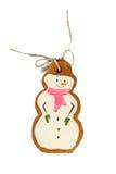 Bonhommes de neige glacés traditionnels de biscuits de Noël de pain d'épice d'isolement Images stock
