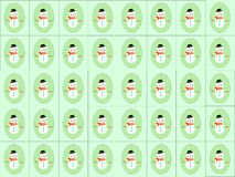 Bonhommes de neige sur le vert Photos stock