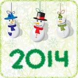 Bonhommes de neige verts 2014 de carte de Noël Images libres de droits