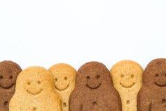 Bonhommes en pain d'épice noirs et blancs Photographie stock libre de droits