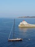 Bonifacio august 2012, sailboat leaving the bay. Sailboat in front of Bonifacio beacon , Corsica, France Royalty Free Stock Photography