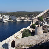 Bonifacio bay and genovese fortifications. Bonifacio limestone cliffs and medieval fortification Royalty Free Stock Photography