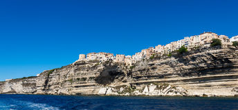 Bonifacio city, Corsica. Landscape of Bonifacio city, Corsica. Buildings and houses on cliff from sea view stock photo