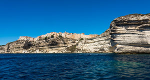 Bonifacio city, Corsica. Landscape of Bonifacio city, Corsica. Buildings and houses on cliff from sea view stock images