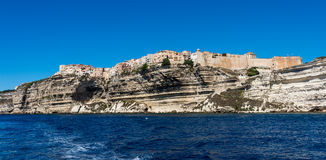Bonifacio city, Corsica. Landscape of Bonifacio city, Corsica. Buildings and houses on cliff from sea view royalty free stock image