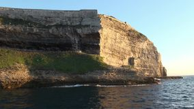 Bonifacio cliff Corse viewed from the sea stock video