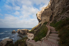 Bonifacio path to cliffs on the shore, Corsica, France Stock Photo