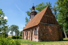 Free Bonin, Zachodniopomorskie / Polska - June 28, 2019: A Small Red Brick Church. Temple With A Wooden Tower In Central Europe Royalty Free Stock Photos - 151823858