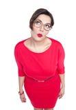 Bonito pensativo mais a mulher do tamanho nos vidros que olham no somet Imagens de Stock Royalty Free