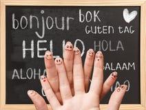Bonjour dans diverses langues sur le tableau Photos libres de droits