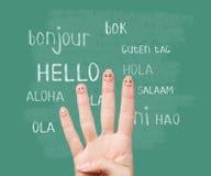 Bonjour dans diverses langues sur le tableau Photographie stock