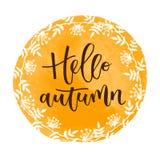 Bonjour inscription écrite par main d'automne Image stock
