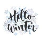 Bonjour inscription écrite par main d'hiver Photographie stock