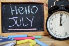 Bonjour juillet De nouveau au concept d'école photographie stock