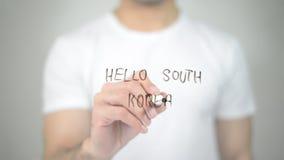 Bonjour la Corée du Sud, écriture d'homme sur l'écran transparent Photographie stock libre de droits