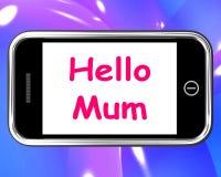 Bonjour la maman au téléphone montre le message et meilleurs voeux Photo libre de droits