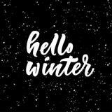 Bonjour lettrage d'hiver sur le fond noir Photo libre de droits