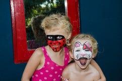 Bonjour peinture de visage de minou et de coccinelle Images stock