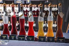 Bonn Germany 17.12.2017 crystal Glass bottles filled with different brandy liqueur variations sold on christmas market royalty free stock photos