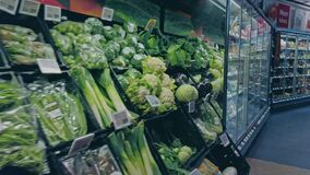 Bonn, Germany - 14 of Dec., 2019: interior shot of REWE supermarket in Bonn POV view. Healthy eating vegetables on the