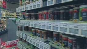 Bonn, Germany - 14 of Dec., 2019: interior shot of REWE supermarket in Bonn POV view. Shelves with seasonings. Lots of