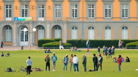 Bonn, Germany, 02 of November 2017: Multiethnic Students In Park In Front Of Bonn University In Good Autumnal Weather. Bonn, Germany, 02 of November 2017 stock footage