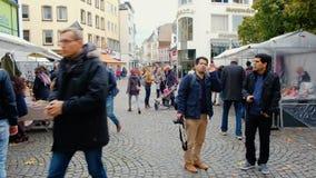 Bonn, Germany, 23 of October 2017: Multi-ethnic People Walking Flea Market In The Center Of Bonn.