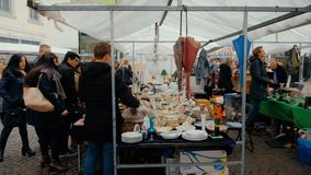 Bonn, Germany, 23 of October 2017: People Choose Plates on Flea Market In The Center Of Bonn.