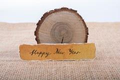 Bonne année écrite sur un papier déchiré Image stock