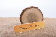 Bonne année écrite sur un papier déchiré Photos libres de droits