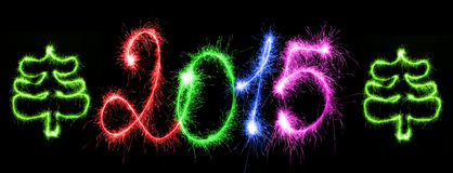 Bonne année - 2015 avec des cierges magiques Images stock