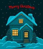Bonne année, carte de voeux saisonnière de joyeux hiver de réveillon de Noël et de nuit avec décoré de la maison de lumières mené Photographie stock