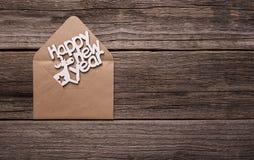 Bonne année d'inscription sous enveloppe image stock