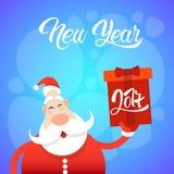 Bonne année de carte de voeux de Joyeux Noël de Santa Claus Hold Big Present Box Photographie stock