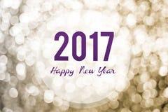 Bonne année 2017 sur le fond d'or de lumière de bokeh, gre de vacances Image stock