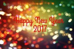 Bonne année 2017 sur le fond de tache floue de bokeh Image stock