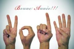 Bonne-annee 2014, guten Rutsch ins Neue Jahr 2014 geschrieben auf französisch Lizenzfreie Stockfotografie
