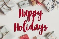 Bonnes fêtes texte, signe saisonnier de carte de voeux fla de Noël Image stock