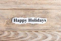 bonnes fêtes texte sur le papier Word bonnes fêtes sur le papier déchiré texte debout de reste d'image de figurine de concept de  Photo libre de droits