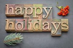 Bonnes fêtes dans le type en bois Photographie stock libre de droits