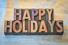 Bonnes fêtes dans le type en bois d'impression typographique Photo stock