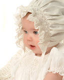 Bonnet Baby. Closeup of baby girl in bonnet Royalty Free Stock Images