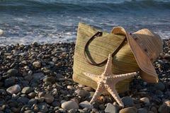 A bonnet, a bag and a seastar Stock Photos