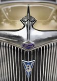 Bonnet and emblem of a restored 1934 Ford Sedan. 1934 Ford Deluxe Sedan. Like the one driven by Clyde Barrow that fateful day in May 1934 Royalty Free Stock Image