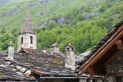 BONNEVAL-SUR-ARC, FRANCE: The church and traditional houses in Vanoise National Park, Northern Alps. The church and traditional houses in Vanoise National Park Stock Images