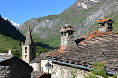 BONNEVAL-SUR-ARC, FRANCE: The church and traditional houses in Vanoise National Park, Northern Alps. The church and traditional houses in Vanoise National Park Stock Photo
